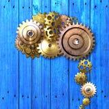 Шестерня металла на голубой деревенской деревянной доске meterial дизайн Стоковая Фотография RF