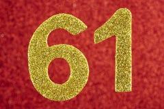 Шестьдесят один желтый цвет над красной предпосылкой годовщина Стоковое Изображение