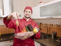 Шеф-повар в кухне. Стоковое Фото
