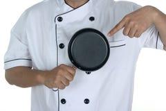 Шеф-повар держа сковороду Стоковые Фото