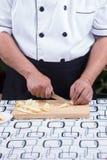 Шеф-повар режет мозоль младенца Стоковое Изображение