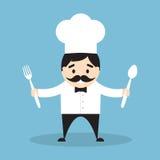 Шеф-повар с вилкой и ложкой Стоковое фото RF
