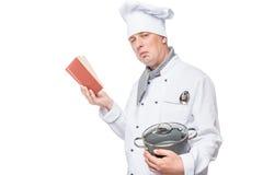 Шеф-повар с книгой и лотком Стоковые Изображения