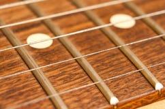шея гитары крупного плана Стоковые Фотографии RF