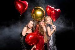 Шикарные женщины с воздушными шарами Стоковое фото RF