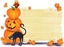 Шильдик хеллоуина с тыквами, котом и сычом Стоковое Изображение RF