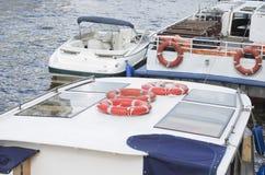 Шины реки с lifebuoys Стоковая Фотография