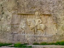 Шираз, PERSEPOLIS, Naqsh-e Rustam, Иран Барельеф персидской империи стоковое фото
