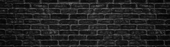 Широкая черная текстура кирпичной стены Темная панорамная предпосылка стоковое фото