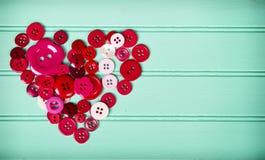 Шить кнопки в форме сердца стоковое изображение