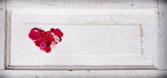 Шить кнопки в форме сердца стоковое изображение rf