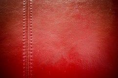 Шить красная кожаная предпосылка текстуры Стоковые Фотографии RF