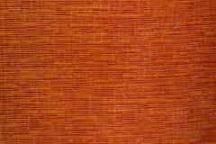 шить померанцового красного цвета ткани стоковые фото