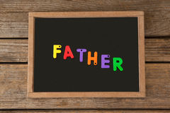 Шифер с текстом отца на таблице Стоковые Фото