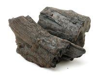 Шишка 2 угля сделанная из древесины стоковые фото