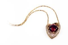 Шкентель сердца форменный с красным камнем Стоковые Фотографии RF