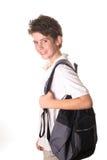школа мальчика книги мешка Стоковое Фото