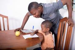 Школьник и домашний учитель 2 Стоковые Фото