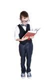 Школьник при книга изолированная на белой предпосылке Стоковые Изображения