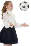 Школьница с шариком футбола Стоковое Изображение