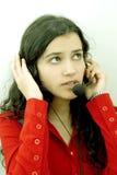шлемофон девушки Стоковое фото RF