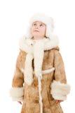 шлем девушки пальто смотря овчину вверх Стоковое Фото