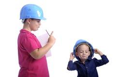 шлем мальчика немногая reprimanding Стоковое Фото