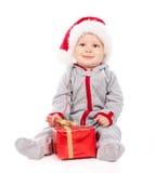 шлем подарка рождества коробки младенца играя santa Стоковое Изображение