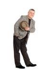шлем приветствию его давления человека Стоковая Фотография RF