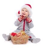 шлем рождества шариков младенца играя santa Стоковая Фотография RF