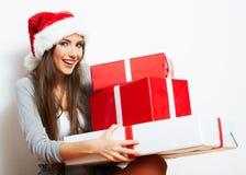 Шлем Санта рождества изолировал подарок рождества владением портрета женщины Стоковые Фото