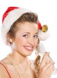 шлем santa привлекательной девушки шампанского стеклянный Стоковое фото RF