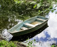 Шлюпка на пруде Стоковые Фото