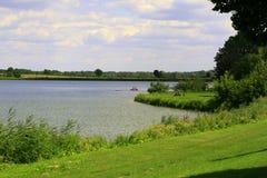 Шлюпка озера и педали Стоковые Изображения RF