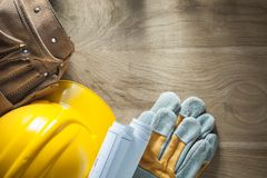 Шляпа кожаных перчаток безопасности планов строительства пояса инструмента трудная Стоковая Фотография RF