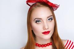 Шляпа красного цвета женщины Стоковые Фото