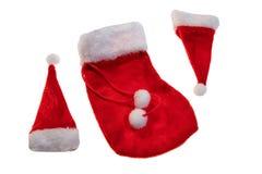 Шляпа Санта Клауса красная изолированная на белой предпосылке стоковые фото