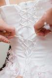 шнуровка платья вверх по венчанию Стоковая Фотография
