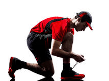Шнуровка jogger бегуна обувает силуэт Стоковое Изображение