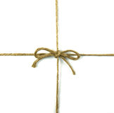 Шнур связанный в смычке на белизне стоковые изображения rf