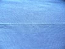 Шов голубой ткани хлопка стоковые изображения rf