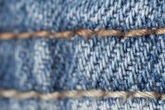 шов макроса голубых джинсов Стоковое фото RF
