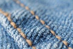 шов макроса голубых джинсов Стоковое Изображение RF