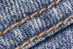шов макроса голубых джинсов Стоковые Изображения
