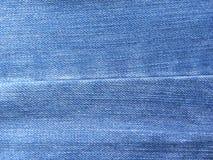 Шов на голубых джинсах цвета стоковое фото