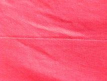 Шов на красной ткани стоковые изображения