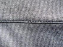Шов на серой ткани цвета стоковое изображение rf