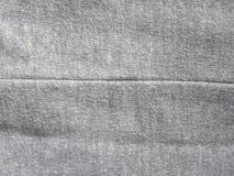 Шов темного - серая хлопко-бумажная ткань стоковые изображения