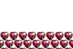 Шоколад в форме сердц на белой предпосылке Стоковая Фотография