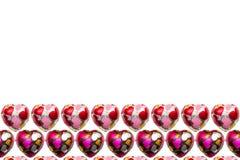 Шоколад в форме сердц на белой предпосылке Стоковые Изображения